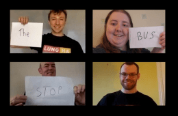 4 people on zoom, one holds a piece of paper saying 'The', another with one saying 'Bus', another saying 'Stop' and the final is smiling