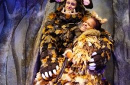 A young person and an older person dressed up as fantastical creatures.
