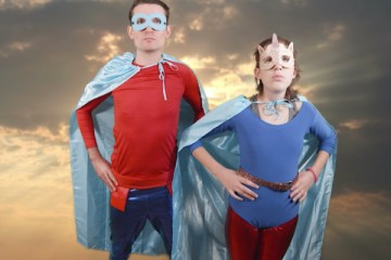 Man and Woman dressed as superheroes