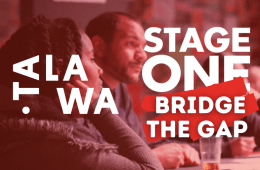 A woman and man are sitting engaged at a table. The words Talawa and Stage One; Bridge the Gap are in the foreground of the image