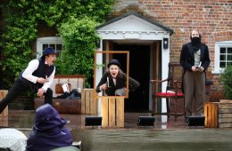 The cast on Hound of the Baskervilles performing on stage