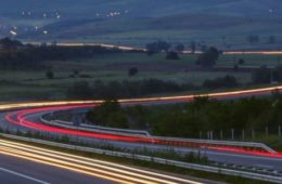 A long exposure image of a winding highway.