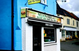 A picture of the front of a fish and chips restaurant.