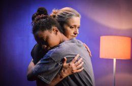 Two women embracing.
