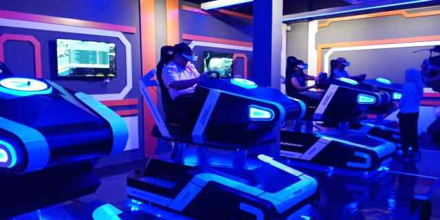 AZAM Sarawak staff experiencing the VR Gatling Fun, one of the  many VR games available at the D-Virtual Park.