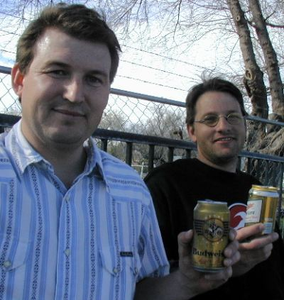 Chris Farell and Matt Thrasher enjoy a cold one in the park.