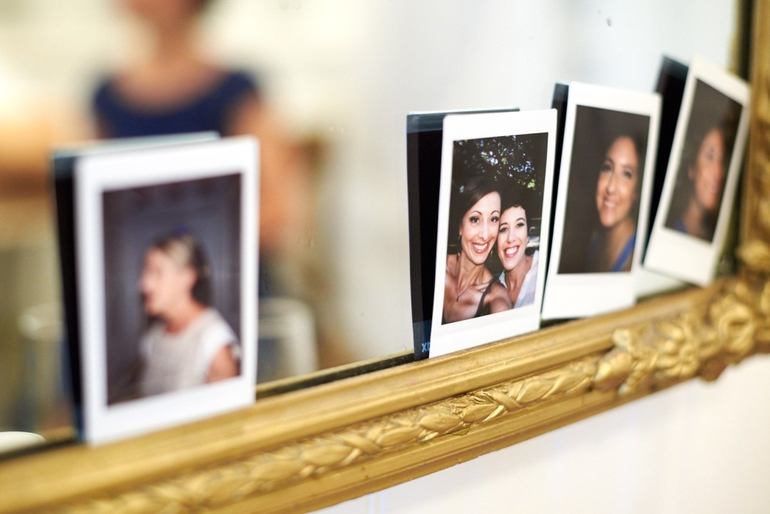 Instant wedding pictures on mirror frame.