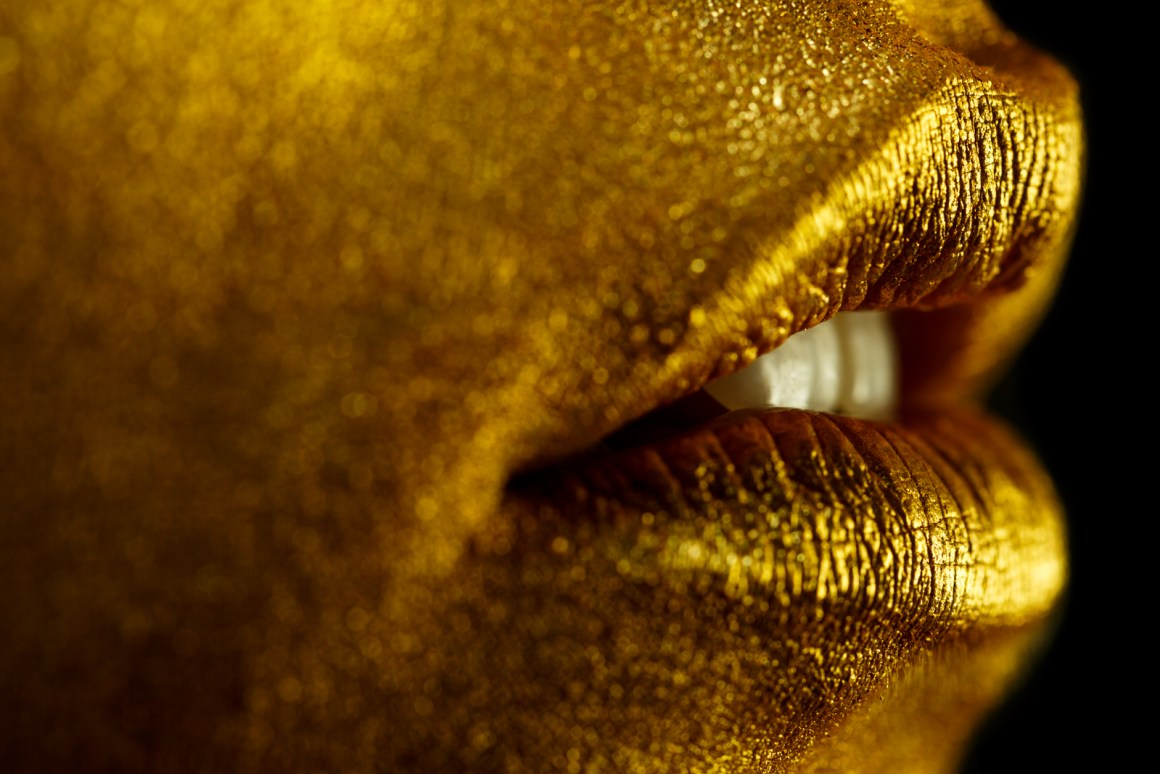 Gold. Love working with Livia from All Dolled Up and Najatt, our model for this Bond themed shoot. Mesmerized by how the gold shimmers in and out of focus. You should see this on a metallic paper print. Would look great on someone's wall!
