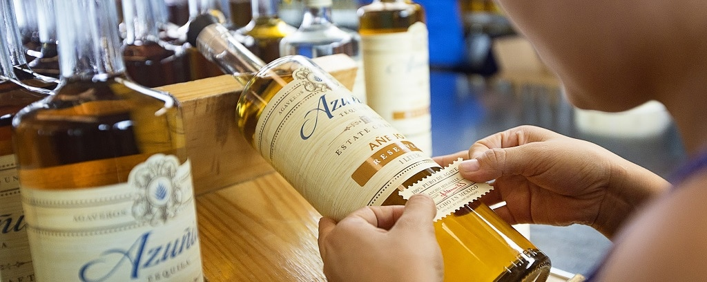 Azunia Tequila is hand-labeled