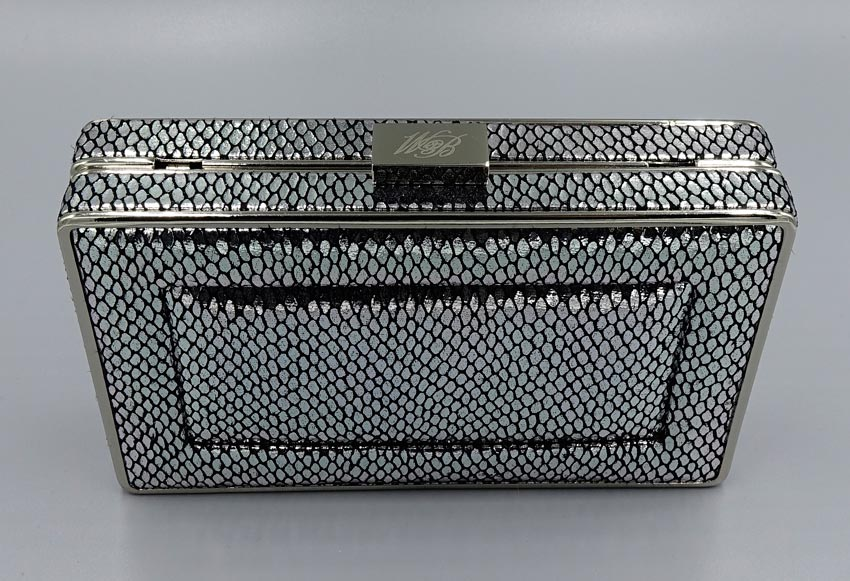 By sonia talati this month, penta is sponsored by: White House Black Market Three Way Clutch Silver Snakeskin Print