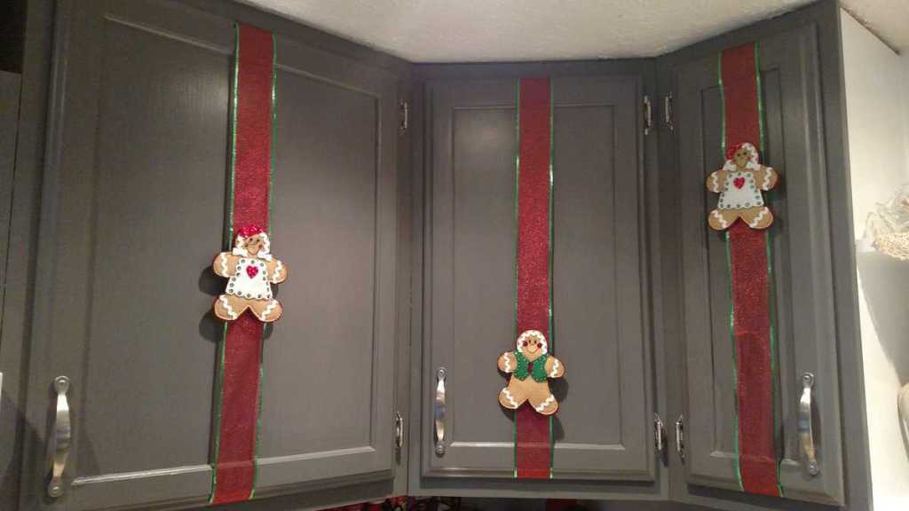 Gingerbread men on ribbons on kitchen cupboard doors
