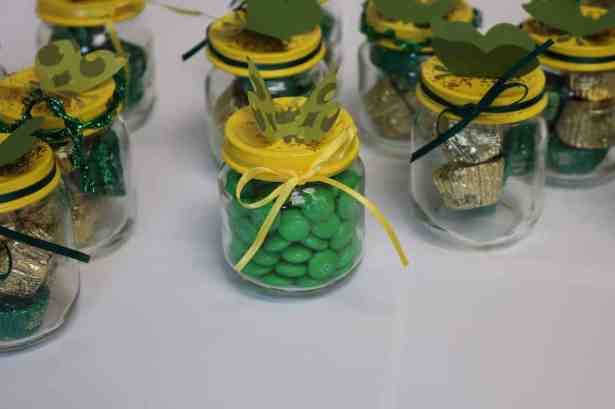 front of jars with green M+Ms in them https://www.b4andafters.com/Baby-Shower-Favors