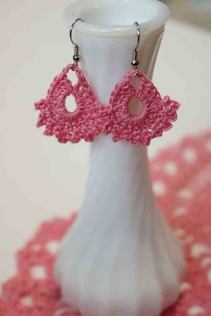 pink earrings hanging from a vase https://www.b4andafters.com/easy-crocheted-earrings/