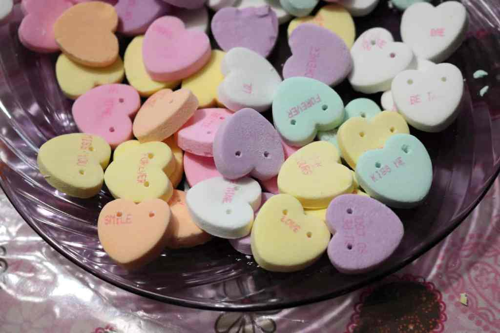 candy hearts with holes drilled into them https://www.b4andafters.com/conversation-heart-garland