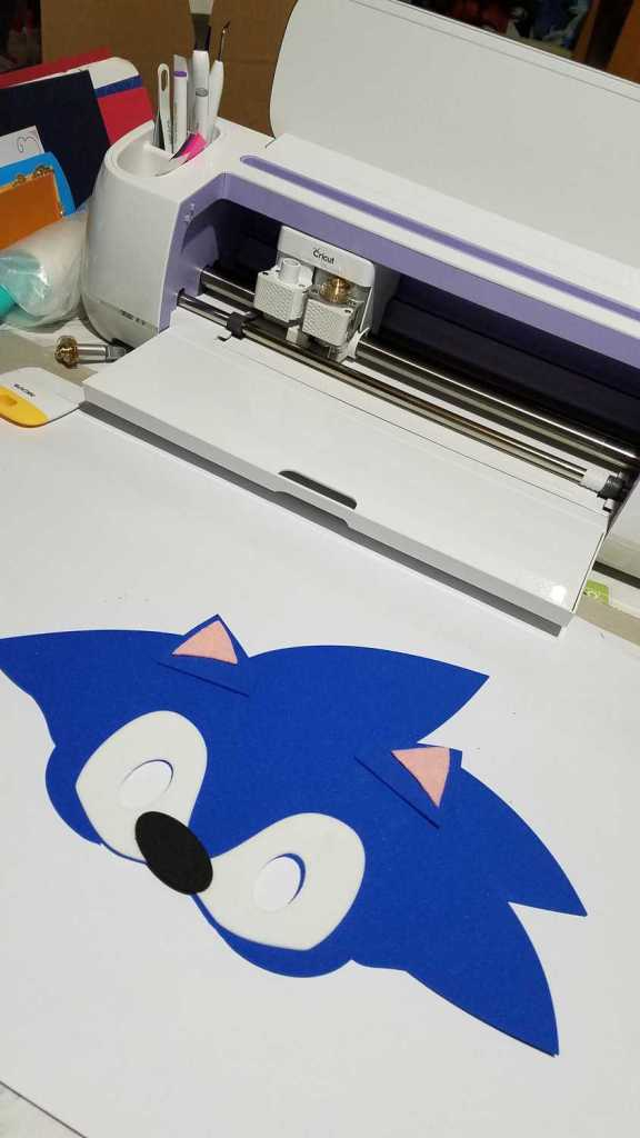 sonic face shape with Cricut machine in background