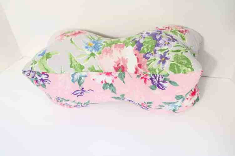 pink floral bone shaped travel pillow