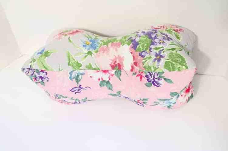 pink floral bone shaped travel pillow