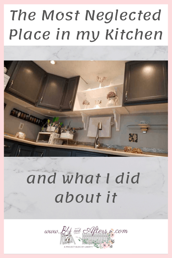 picture of upper gray kitchen cabinets from an angle close to the floor