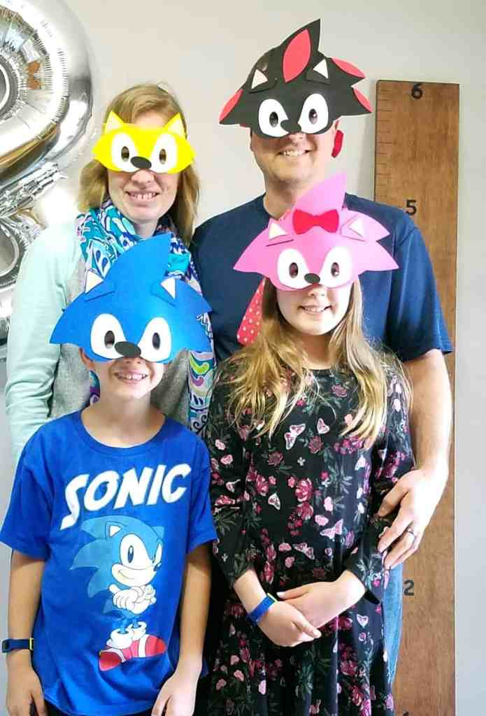 family of four wearing Sonic the Hedgehog face masks