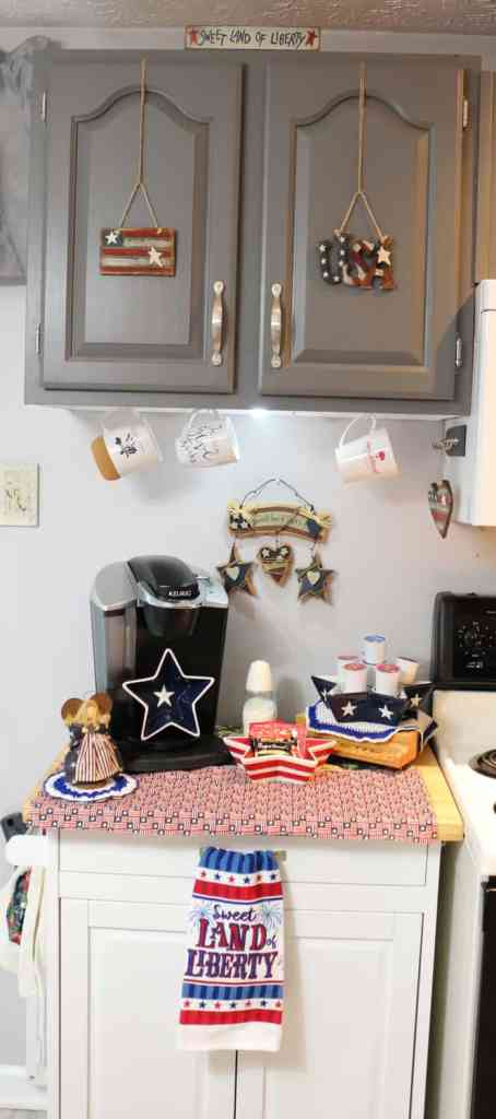 Kitchen coffee station decorated for the fourth of July with wooden elements