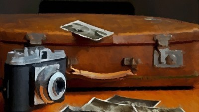 Travel camera and suitcase with old photographs