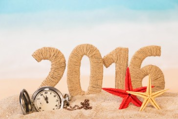 2016 happy new year concept with sand and clock