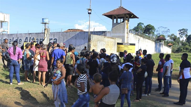 The riot erupted when a group of prisoners reportedly tried to take over another part of the prison complex [Wilson Soares/AP]