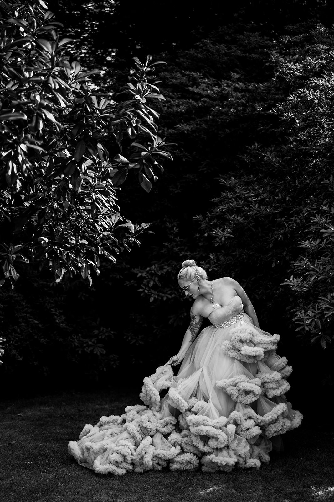 Black and white image of bride in big wedding dress