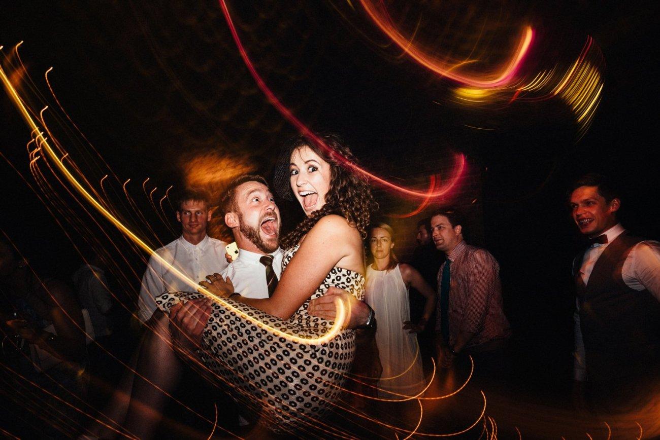 Man lifts girl Shoreditch wedding