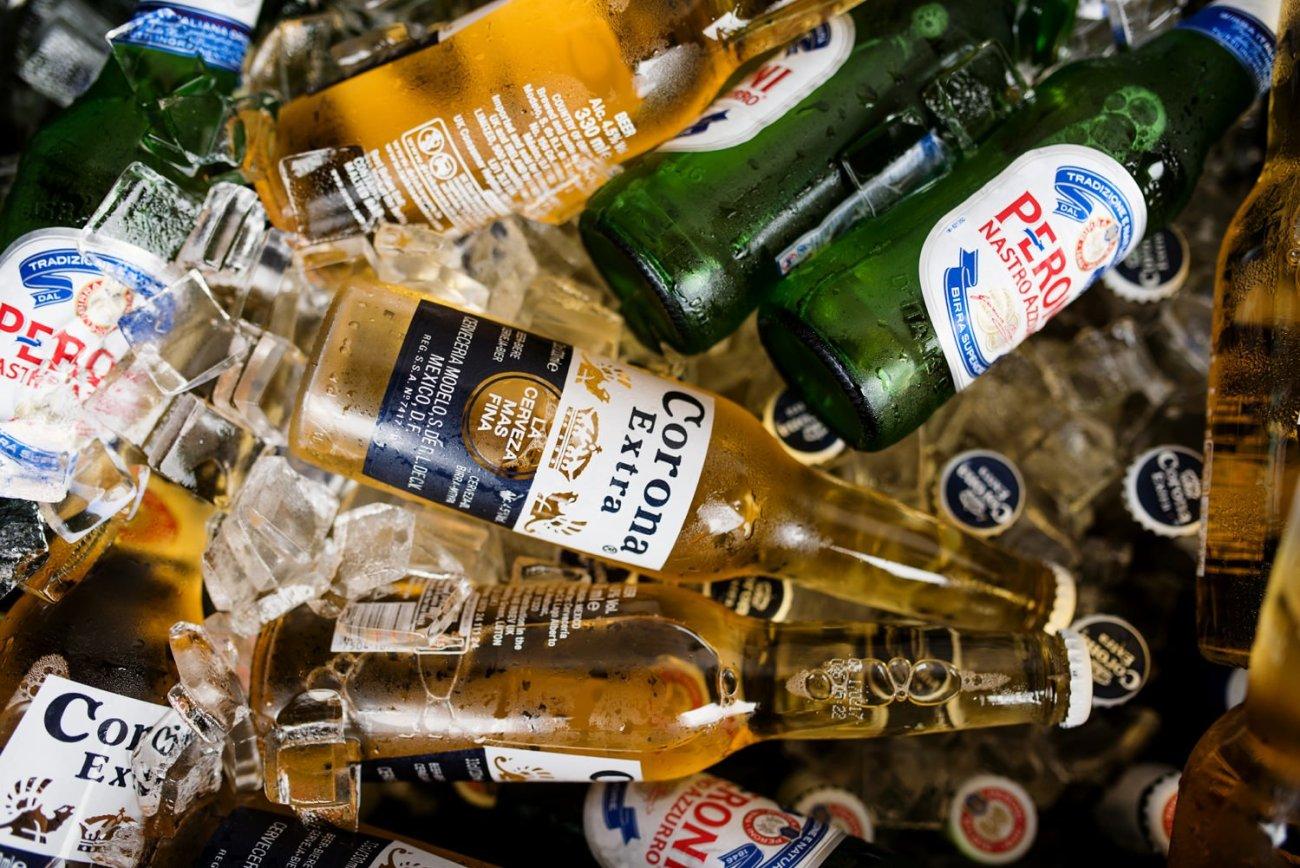 Bottles of beer good times at Devon beach wedding