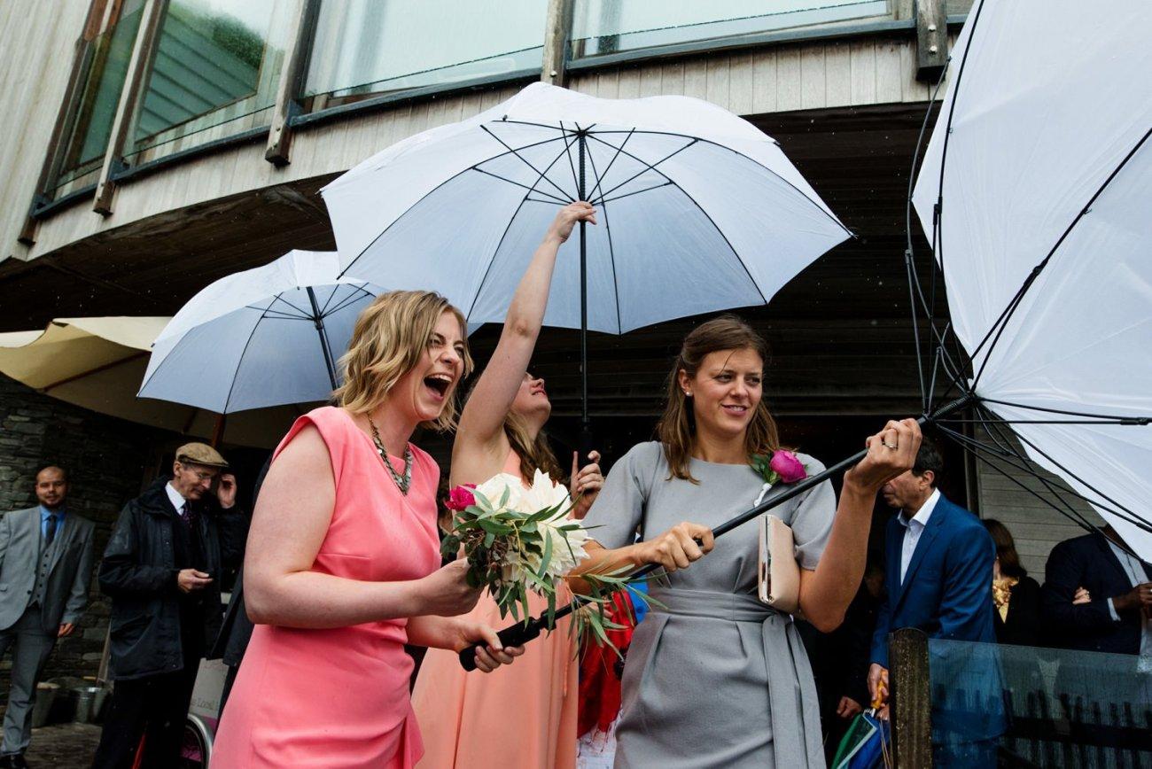 Fun and giggles despite rain and winds Devon wedding photography Babb Photo