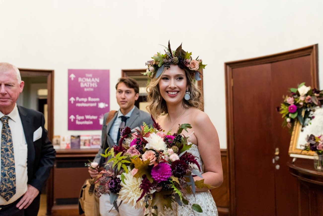 Bride wearing floral crown with bouquet by Flowers by Passion Bath, Somerset