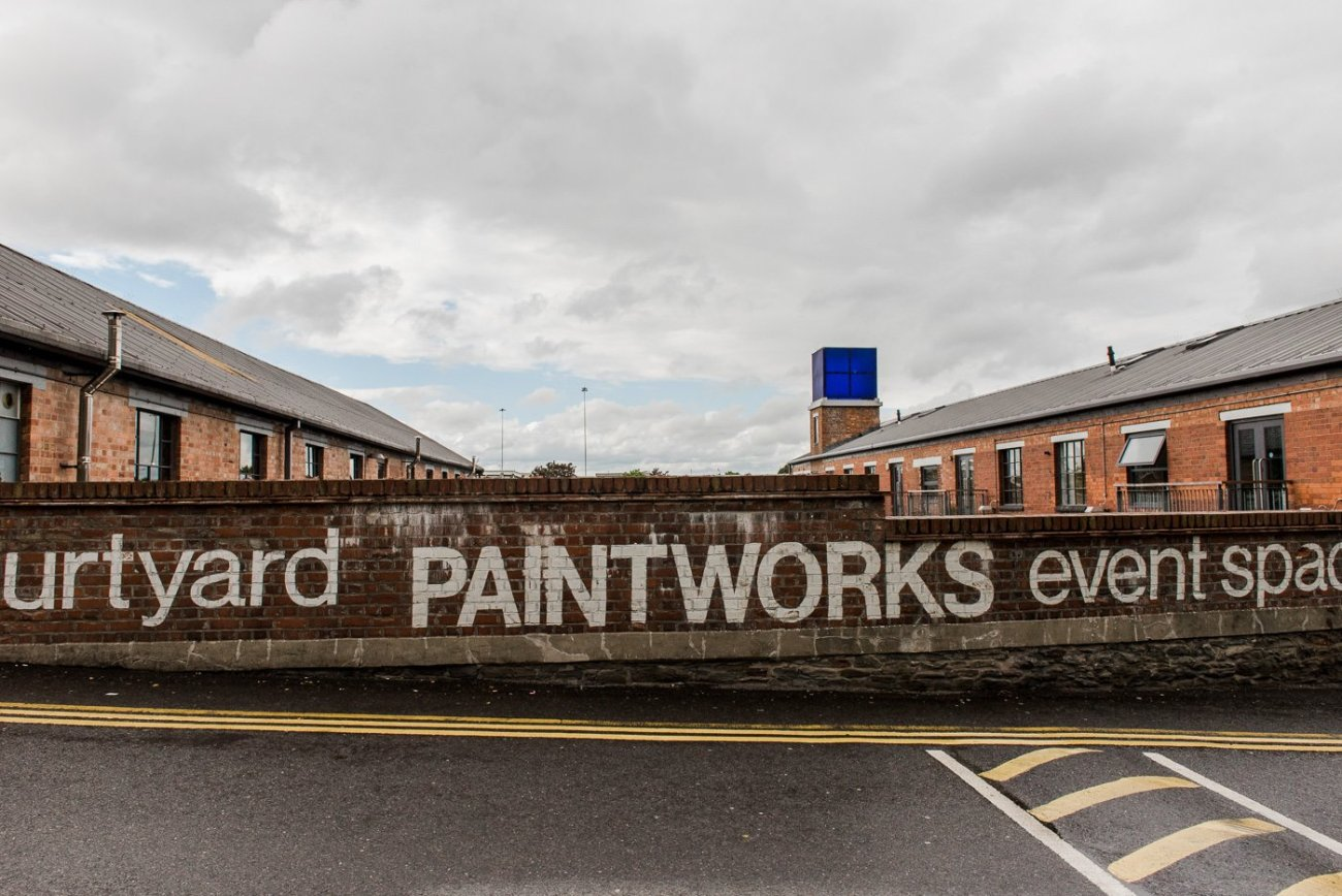 The wall outside of The Paintworks wedding venue in Bristol with Courtyard Paintworks event space painted on it