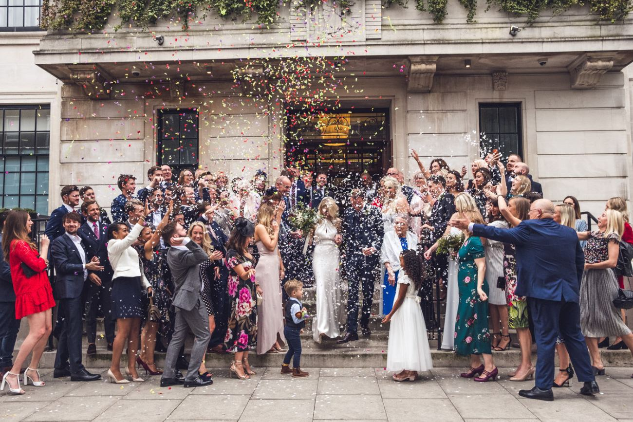 Confetti wedding picture outside the town hall hotel