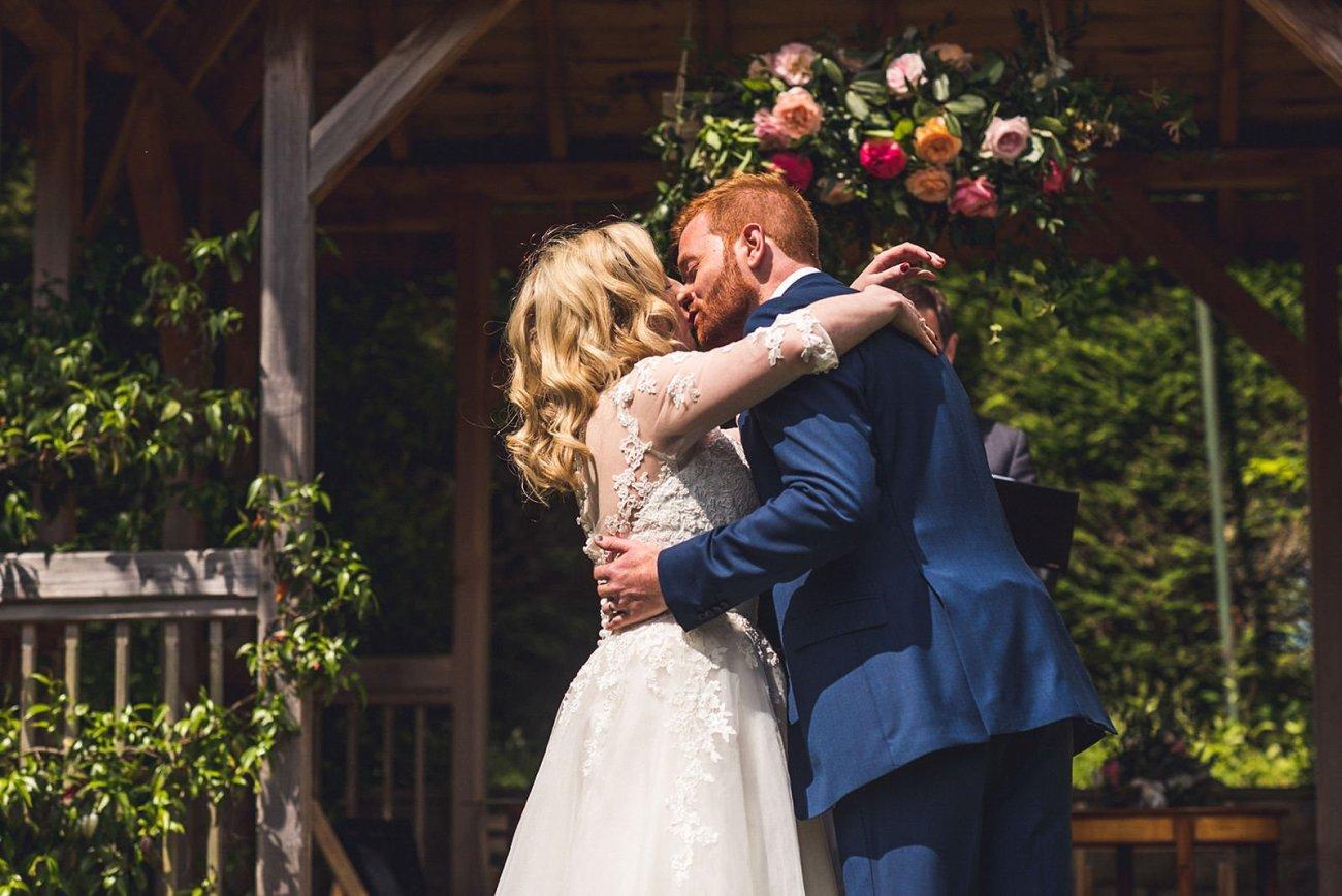 Bride and groom kissing Pennard House wedding photography