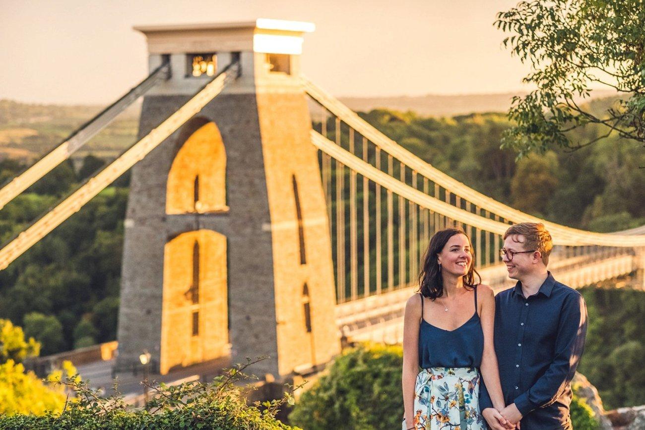Couple laughing bristol suspension bridge sunset