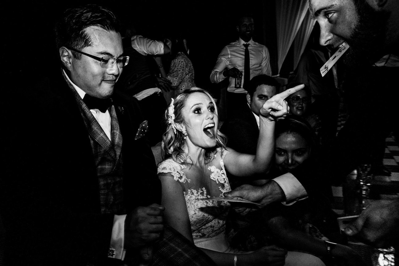Bride excitedly pointing at magician doing trick Dubai wedding
