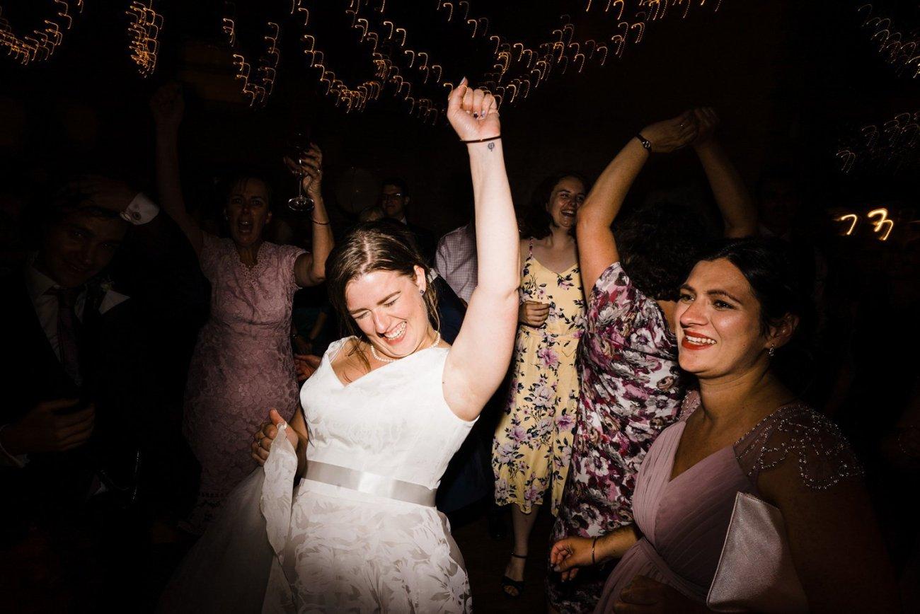 Bride rocking out at kingscote barn wedding