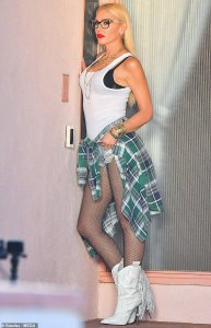 Gwen Stefani models new eyewear collection in daisy dukes and fishnet