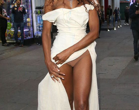 Sinitta Shows Off Legs And More In White Slit Dress