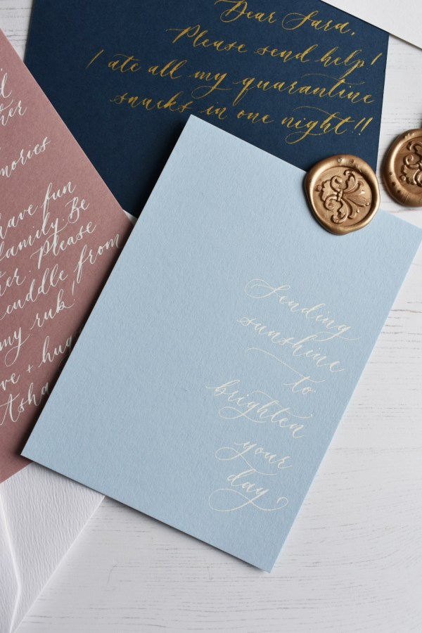 Light blue personalised handwritten note with white calligraphy ink
