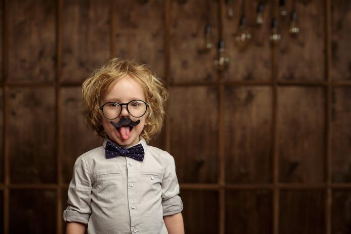 Little boy dressed up as albert einstein in studio