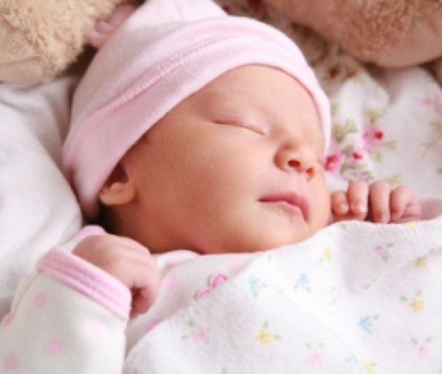Newborn Sleeping With Pink Hat