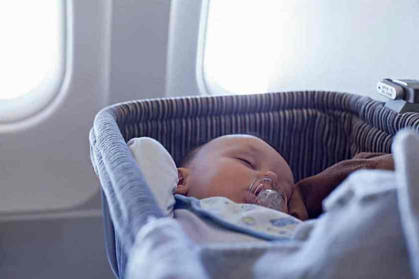 Baby Sleeping in portable traveller crib