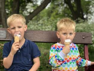 Two boys eating Ice cream from Minchella's south marine park