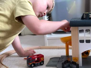 playing with BRIO fire station chute