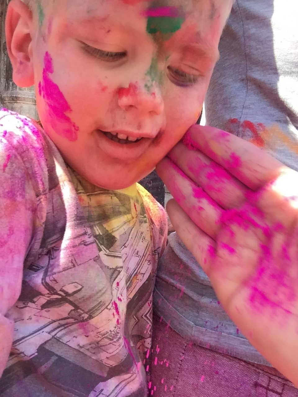 Boy at holi in udaipur with colourful face