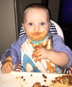 Sonny at 9 months enjoying granny's lasagne