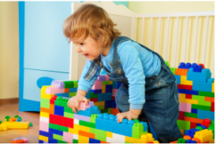 baby playing with Legos