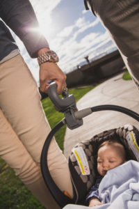 Dad carrying infant carrier with Lugbug handle